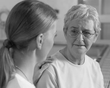 Nurse comforts woman emotionally